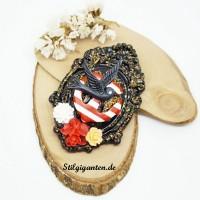 Brosche Ankerform schwarz Anker rot weiss