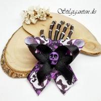 Skeletthand LILA Schaedel